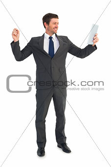 Businessman holding page and tablet