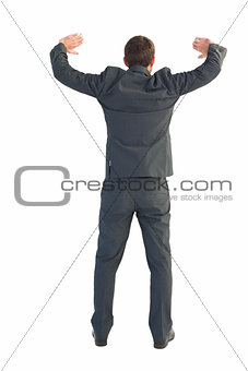 Businessman standing with hands up