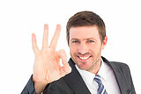 Businessman smiling and making ok sign