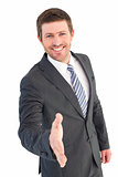 Businessman smiling and offering his hand