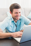 Smiling man on a laptop