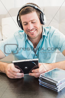A man listening to cds