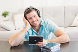Smiling man listening to cds