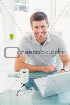 Casual businessman at desk