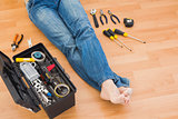 Man legs with toolbox on floor at home