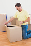 Man open a moving box at home