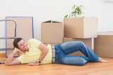 Happy man posing with moving boxes at home