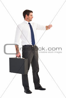 Businessman checking the time while holding briefcase