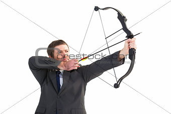 Focused businessman shooting a bow and arrow