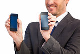 Businessman showing two mobile phone