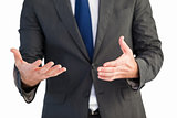 Handsome businessman presenting with hands