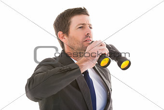 Focused handsome businessman holding binoculars