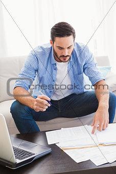 Focused man paying his bills