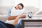 Exhausted man sleeping with head resting on pillow