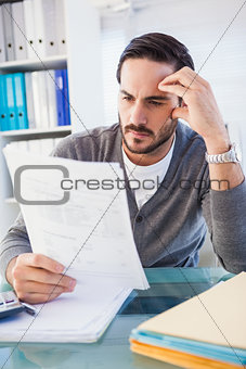 Focused casual businessman working at his desk