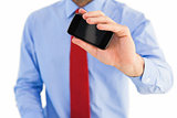 Hand of businessman showing smartphone