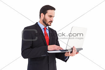 Focused businessman using his laptop