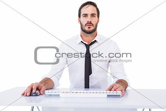 Focused businessman working on computer