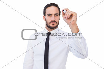 Focused businessman writing with marker
