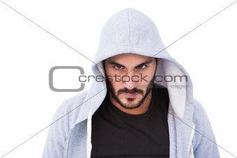 Portrait of dangerous man wearing hooded jacket