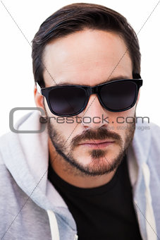Close up of serious man wearing sunglasses