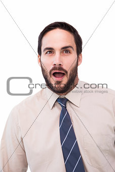 Portrait of shocked businessman with mouth open