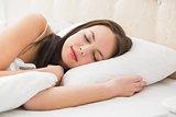 Pretty brunette lying in bed