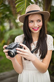 Pretty brunette holding her camera