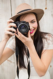 Pretty brunette taking a photo