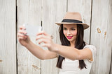 Pretty brunette taking a selfie