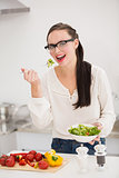 Pretty brunette preparing a healthy salad