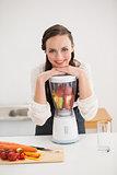 Pretty brunette preparing a healthy juice