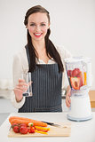 Pretty brunette preparing a healthy juice