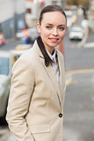 Young businesswoman smiling and walking