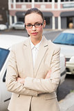 Young businesswoman looking at camera