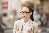 Young businesswoman holding take away coffee