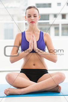 Fit brunette sitting in lotus pose