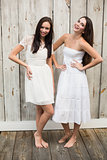 Pretty friends posing in white dresses