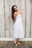 Pretty brunette posing in white dress
