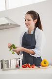 Pretty brunette cooking a healthy meal
