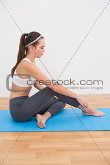 Fit woman doing yoga at home