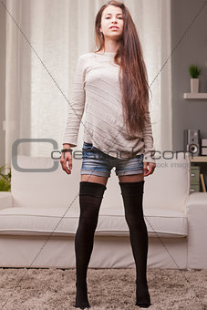 beautiful girl proudly standing on her pretty long legs