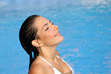 Beauty woman breathing while bathing in a pool in summer
