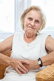 Portrait of an elderly lady sitting in a chair