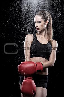 Beautiful woman wearing boxing gloves