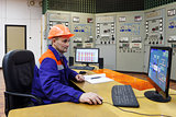 Engineer watching parametrs on monitor