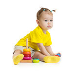 baby girl playing with colorful pyramid isolated