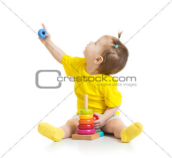 baby playing with colorful toy and looking up isolated