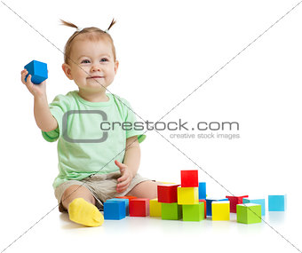 baby playing with colorful building blocks isolated