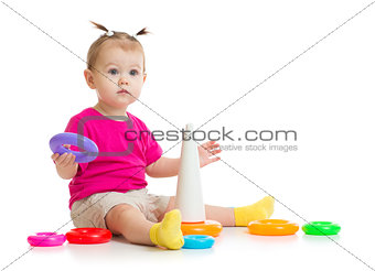 baby playing with colorful pyramid isolated